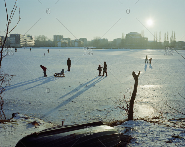 People on snow covered landscape on sunny day