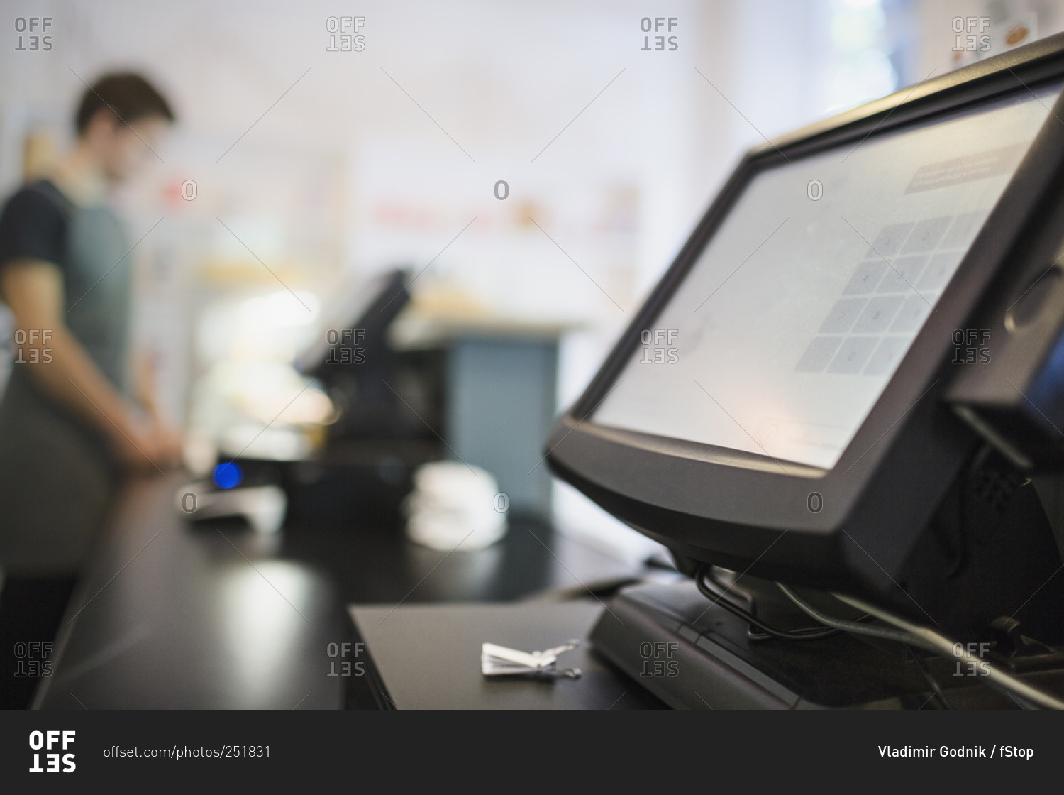 close up of checkout counter with cashier in background at coffee shop stock photo offset. Black Bedroom Furniture Sets. Home Design Ideas