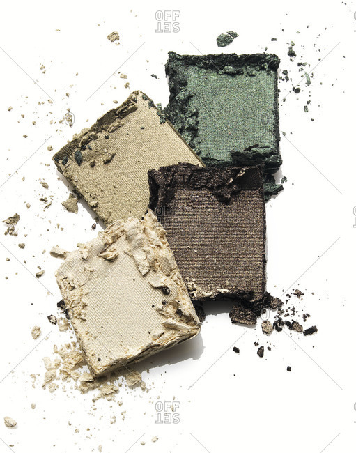 Four squares of crushed powdered eye shadow
