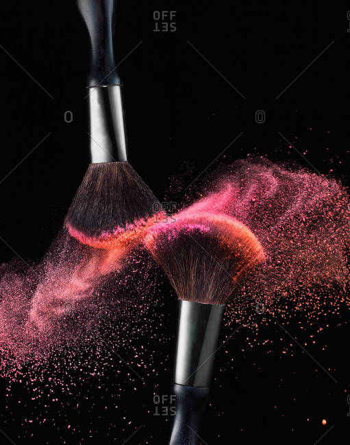 Makeup brushes with pink and coral powdered blush