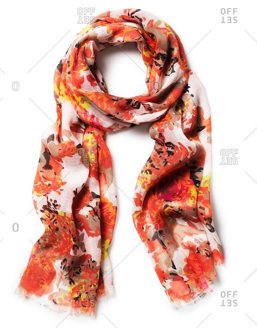Red, orange and yellow flowered women's scarf looped on white background