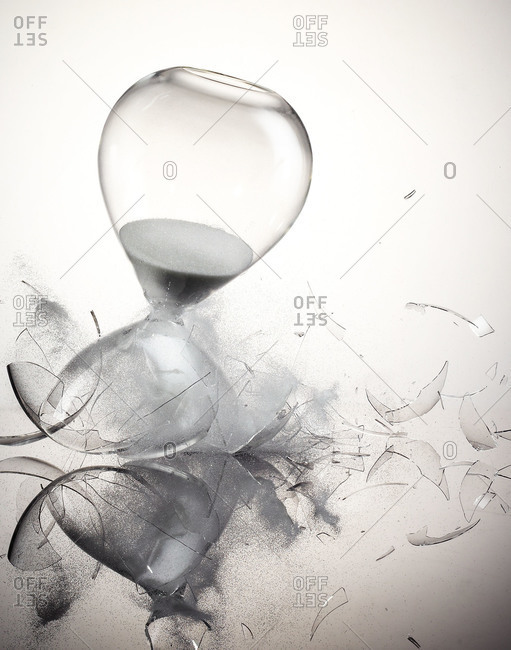 Hourglass shattering white background
