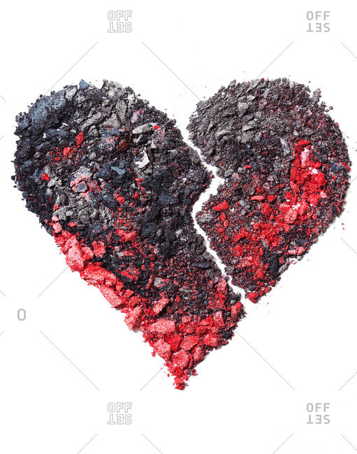 Red and black crushed eye shadow powder sculpted in a broken heart design