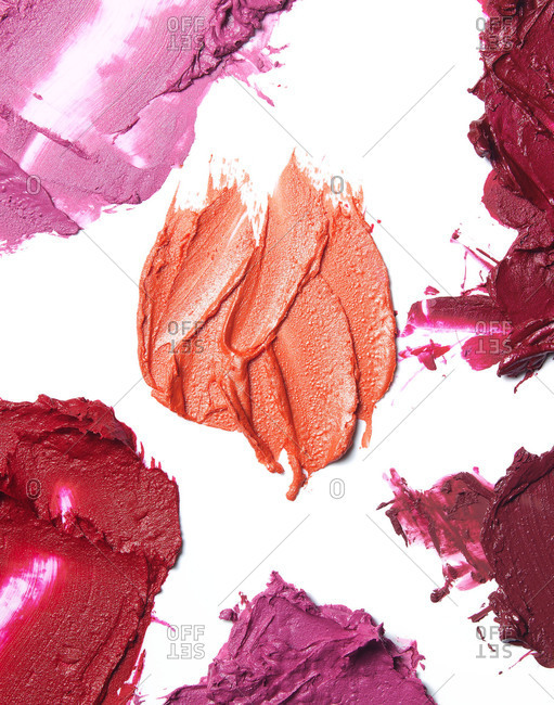 Smears of lipsticks on white background