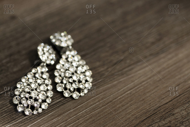 Rhinestone earrings laid out on a table