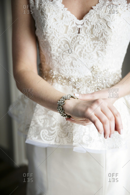 A bride adjusts her bracelet