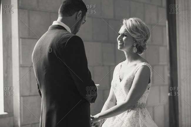A bride smiles at her new husband