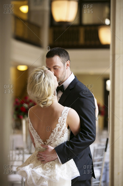 A bride and groom share a private moment together