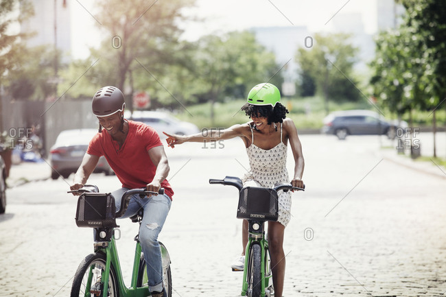 Couple riding bicycles on a city street