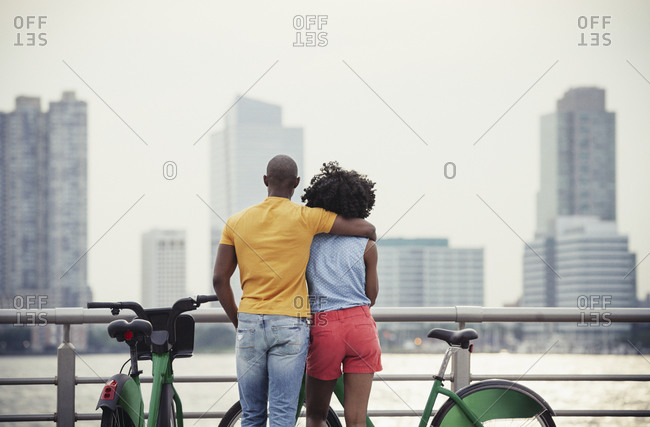 Young couple overlooking a river and city skyline