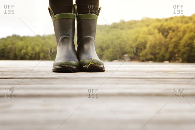 Rubber boots on a pier