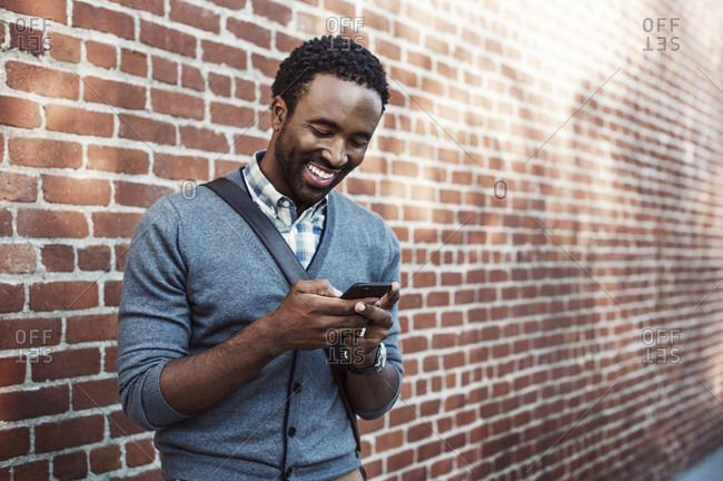 Man looking at his phone and smiling
