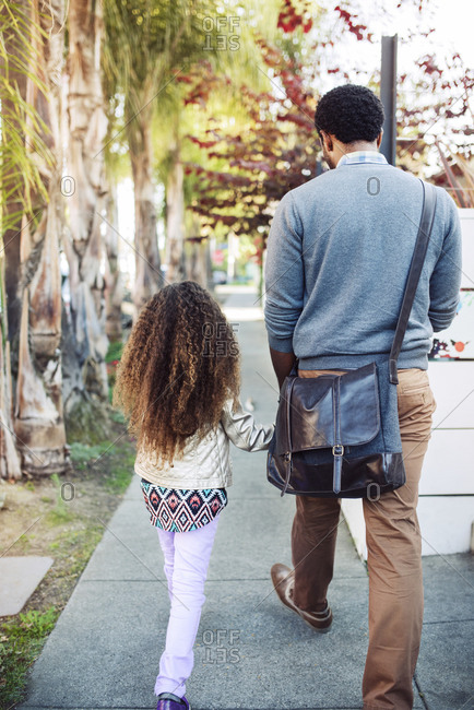 Father and daughter walking together