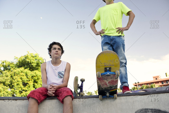 Boys hanging out with skateboards