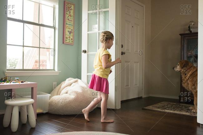 Girl walking toward the front door of her house