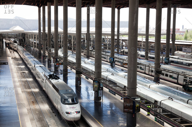 Madrid, Spain - July 30, 2015: Trains in an empty terminal at the Atocha Train Station in Madrid