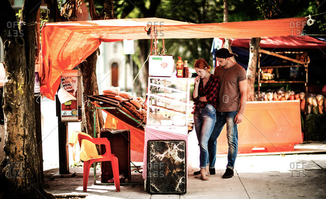 Couple looking at goods at an outdoor market