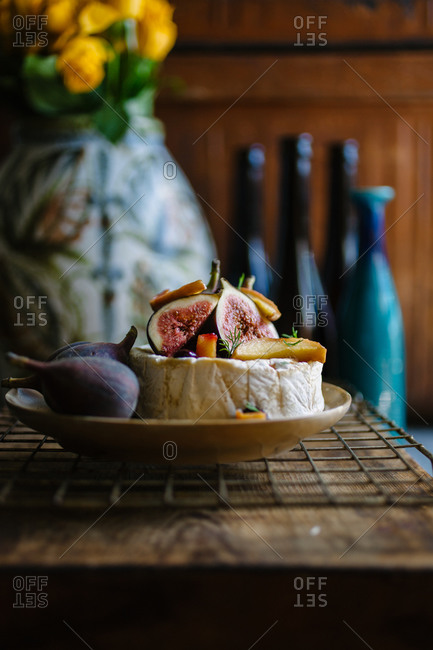 Still life with figs, cheese and vase
