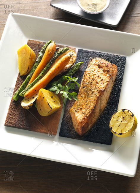 Grilled salmon and summer vegetables on cedar planks