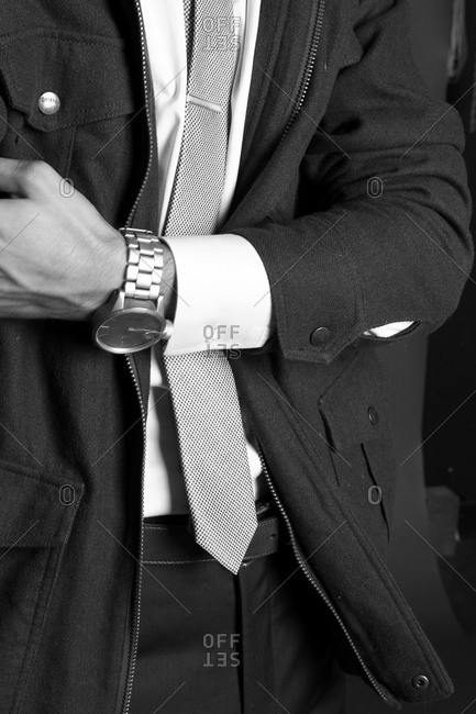 Men's fashion shot with model featuring jacket, tie and watch