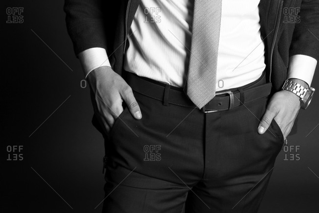 Man with his hands in the pockets of his tailored black pants