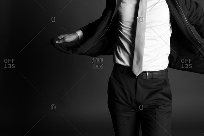 Neck down shot of man modeling business wear