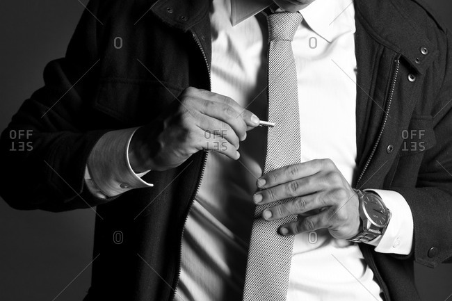 Man putting on a tie clip