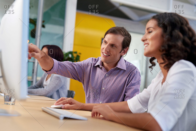 Supervisor explaining a work task to a colleague