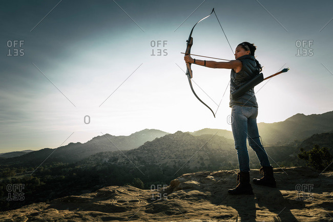 Woman pointing a crossbow
