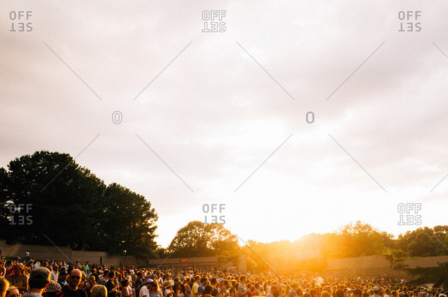 Large crowd of people at an outdoor concert