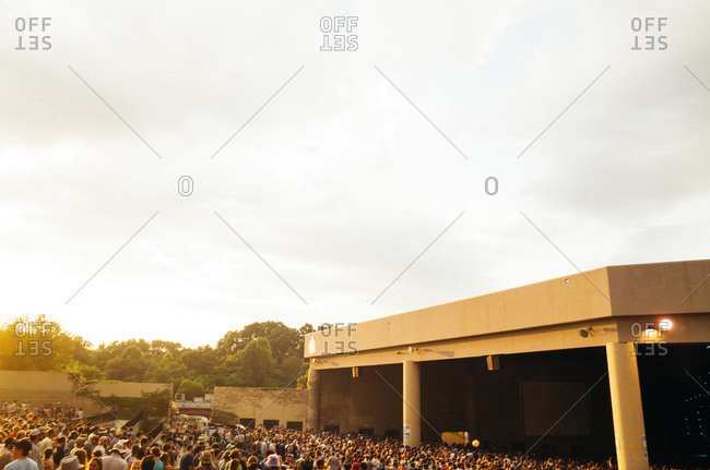 Crowd of people waiting at an outdoor concert