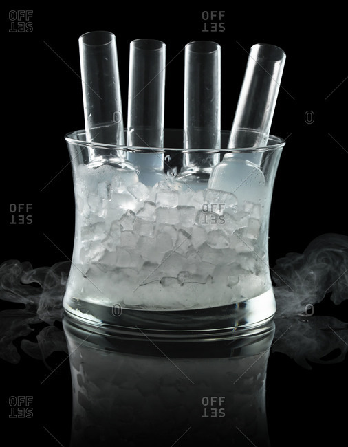 Liquor shots chilling in a glass container