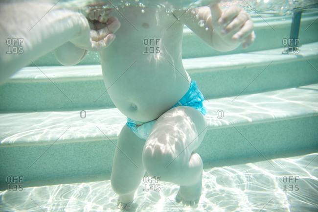 Toddler learning to swim