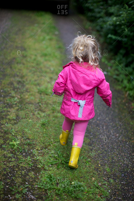 Girl in rain clothes on country path