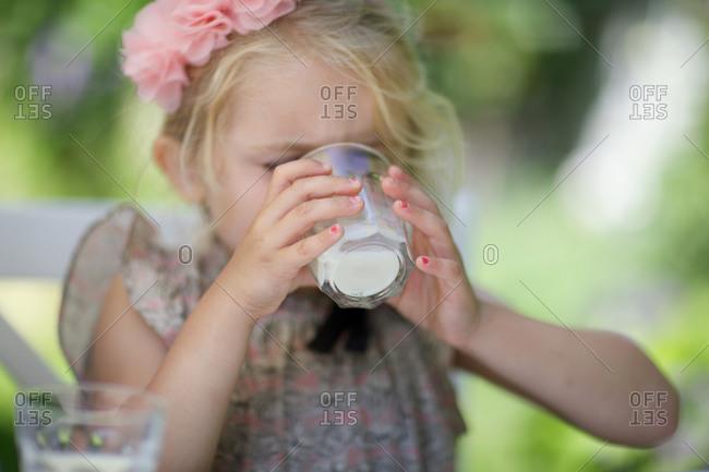 Girl drinking milk from glass