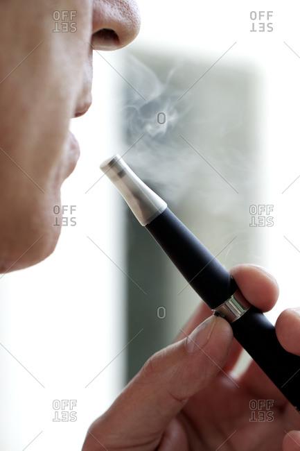 Man smoking an e-cigarette