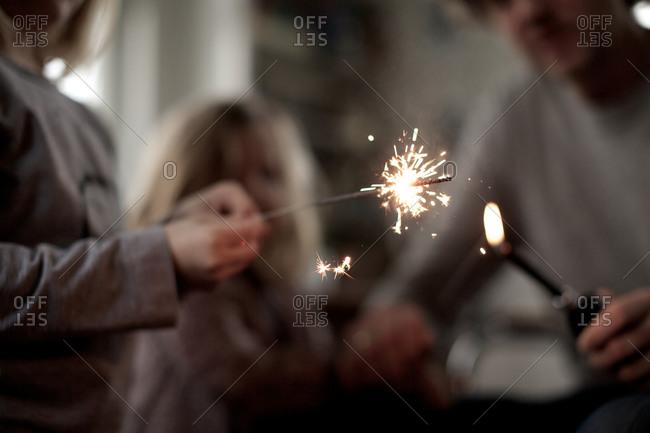 Child holding sparkler toy