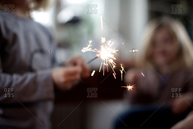 Little kid holding sparkler