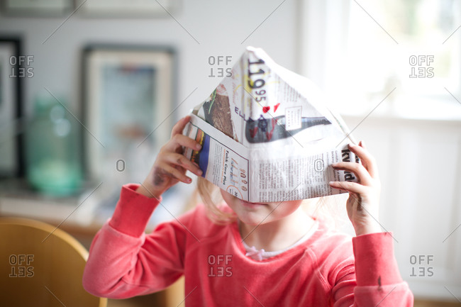 Girl hiding her face in pirate hat