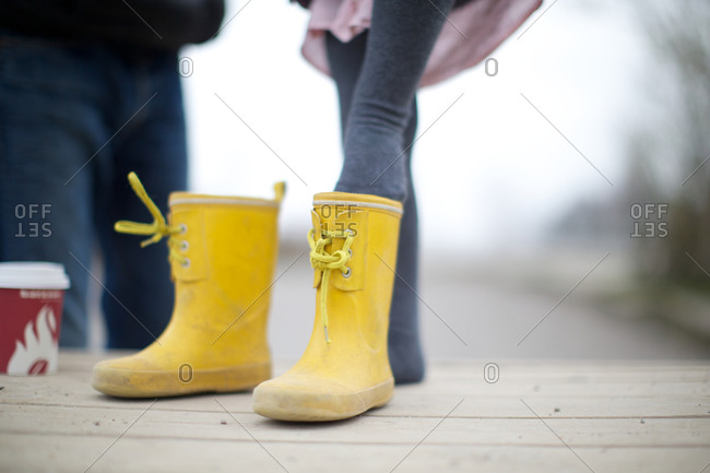 Girl wearing rubber boots in playground