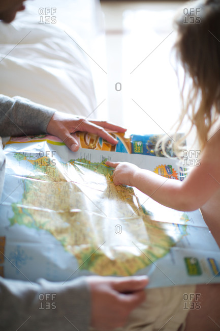 Little girl pointing at the map