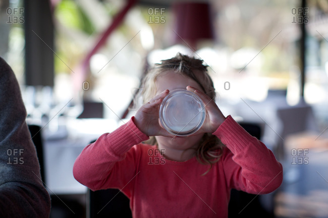 Girl drinking milk in restaurant