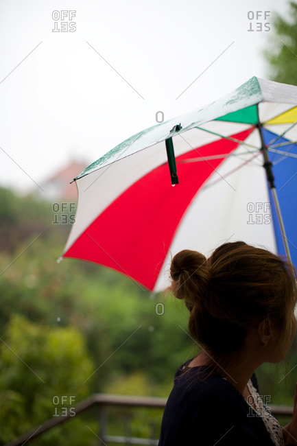 Woman on deck with umbrella