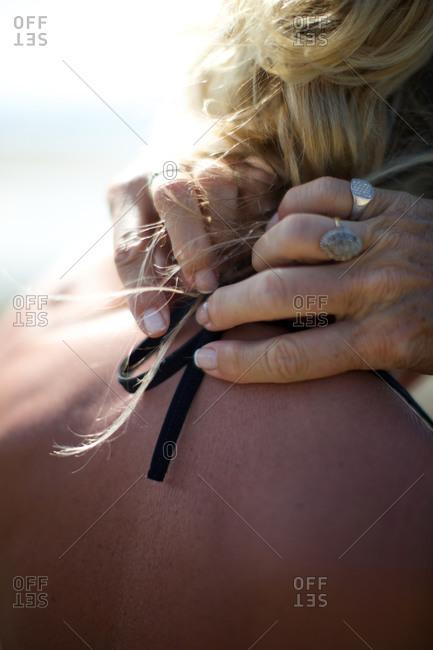 Woman tying bikini top