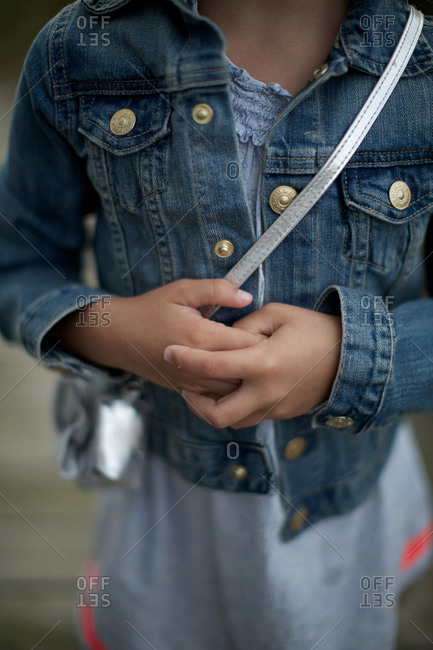 Midsection of girl wearing denim jacket