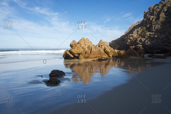 Seascape and rocky cliff in South Africa
