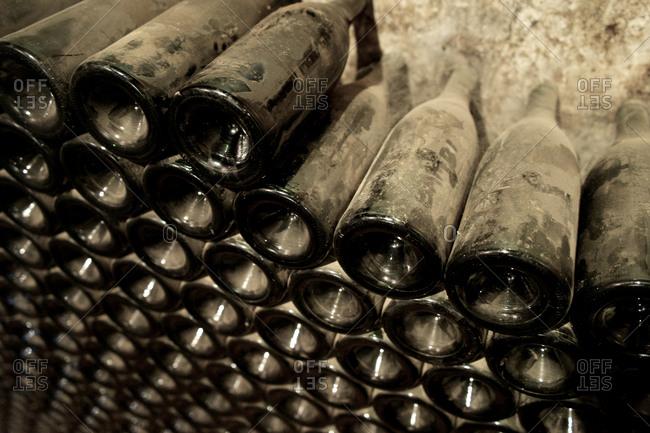 Stack of dusty wine bottles
