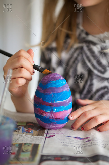 Girl decorating eggs