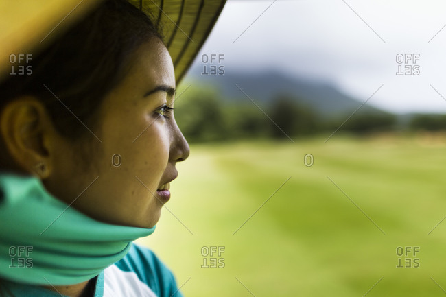 Lang Co, Vietnam - March 25, 2015: A woman at a Vietnamese golf course