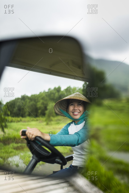 Lang Co, Vietnam - March 25, 2015: A caddie at a golf course along the coast of central Vietnam